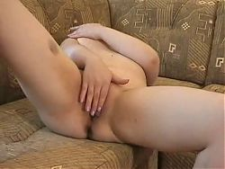 Chubby brunette shows ass
